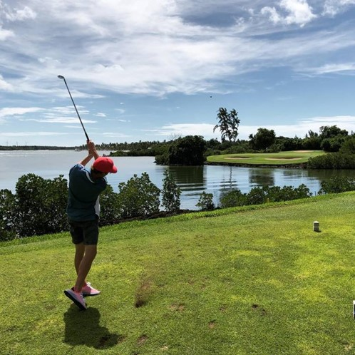 Tom Felton playing golf at Constance Belle Mare Plage