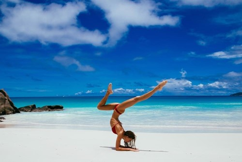 Yoga on a picture perfect beach-constance lemuria
