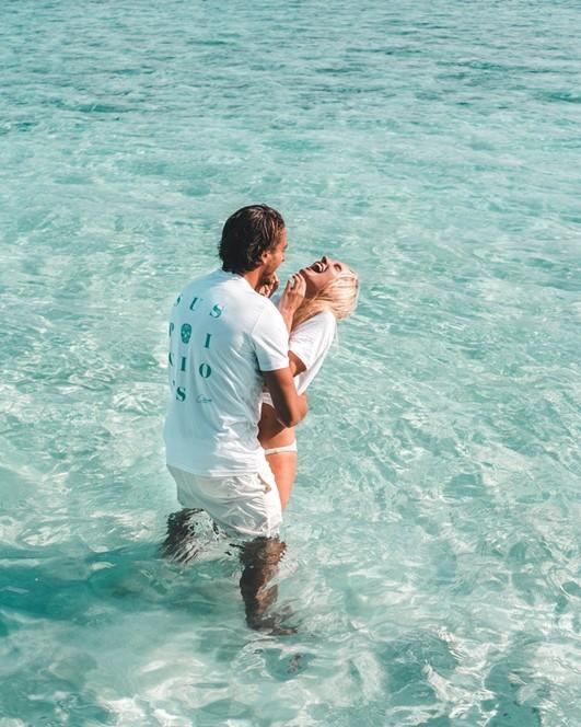 Constance Halaveli Maldives Passport in one hand